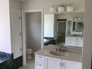 Painted vanities, new hardware, faucets, vanity lighting and shades